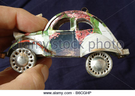 Toys Toy car CLOSE UP hand childs objects studio still life TOY AUTOMOBILE auto AUTOMOBILES CARS handicraft handicrafts - Stock Photo