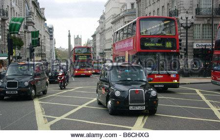 TAXI BUS London England London cab - Stock Photo