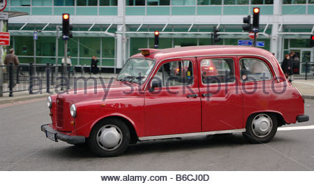Taxi London black cab taxi and london - Stock Photo