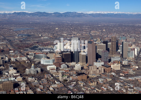 aerial view above Denver Colorado skyline to Rocky Mountain Front Range mountains - Stock Photo