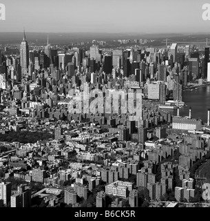 aerial view above Manhattan lower east side toward Empire State building New York city - Stock Photo