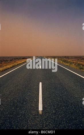 Dust storm in air over highway, outback Australia - Stock Photo