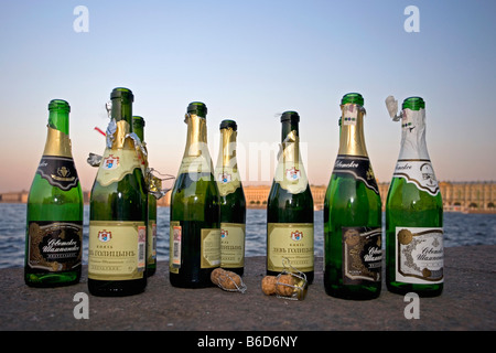 Russia, Saint Petersburg, Couples celebrate their marriage at the border of the Neva river, Bottles of local champagne - Stock Photo