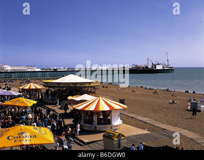 Crowded promenade on Brighton Beach, Sussex, England - Stock Photo