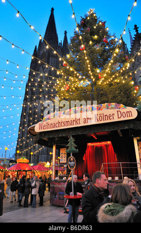Christmas Market (Weihnachtsmarkt) by the Dom, Cologne - Stock Photo