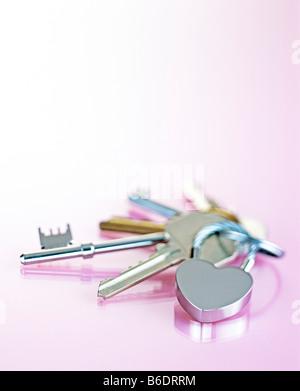 Keys. Set of keys on a heart-shaped pendant keyring. - Stock Photo
