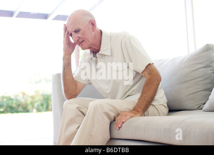 Depression. Unhappy man holding his hand to his forehead. - Stock Photo