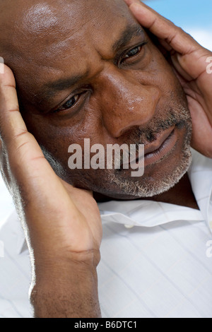 Depression. Unhappy man resting his head on his hand. - Stock Photo
