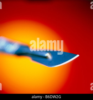 Scalpel, Close-up of a surgical scalpelshowing its razor-sharp replaceable blade. - Stock Photo