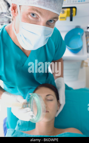 Anaesthesia. Anaesthetist administering gas to a patient. The gas is a anaesthetic that is administered prior to - Stock Photo