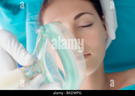 Anaesthesia. Anaesthetist administering gas to a patient. The gas is a general anaesthetic. - Stock Photo