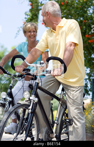 Cyclists. Smiling couple enjoying a cycle ride in the countryside. - Stock Photo