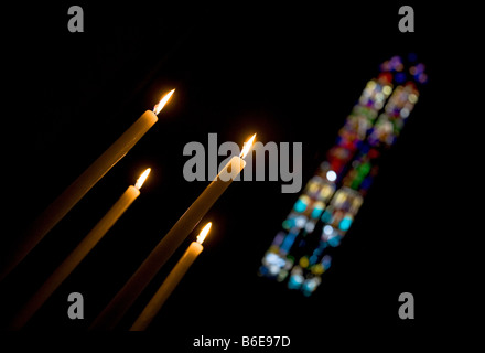 Stained Glass Windows and Candles in Village Church, Lagrasse, Languedoc-Roussillon, France - Stock Photo