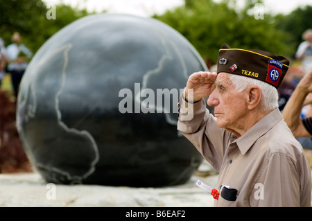 Texan World War II veteran salutes the US flag at a Memorial Day ceremony in Frisco, north Texas. - Stock Photo
