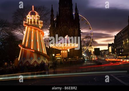 Old traditional wooden Helter-Skelter,  Childrens's fairground slide Scottish Christmas fairground with lights, - Stock Photo