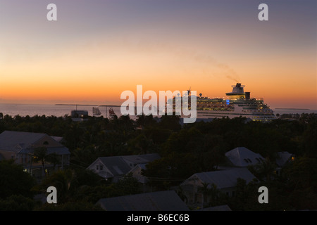 Cruise ship sailing from Key West cruise terminal at sunset, Key West, Florida Keys, USA - Stock Photo
