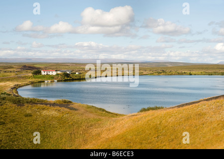 View of Mývatn Lake, with grass-covered pseudocraters.  The lake is in an active volcanic area in northern Iceland - Stock Photo