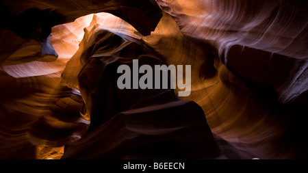 Sunlight through the roof of Upper Antelope Canyon (Tse Bighanilini') - Stock Photo