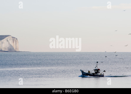 Small fishing boat approaching Newhaven harbour East Sussex UK - Stock Photo