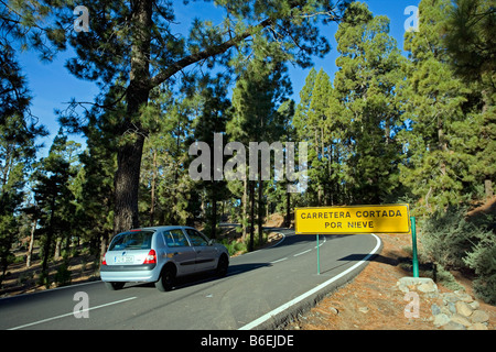Spain, Canary Islands, Tenerife, National Park called TEIDE, Road sign saying that road is blocked due to snow - Stock Photo