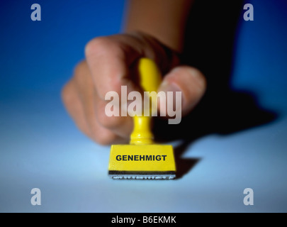 stamp marked in german genehmigt means approved - Stock Photo