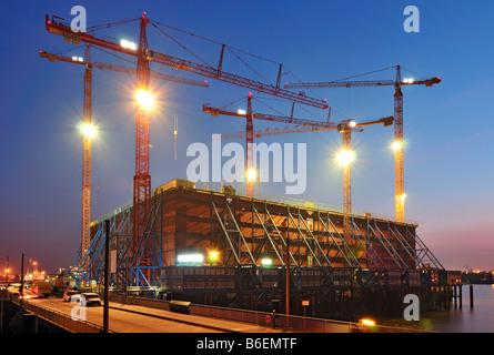 Construction site of the Elbe Philharmonic Hall in Hamburg's HafenCity at dusk, HafenCity, Hamburg, Germany, Europe - Stock Photo
