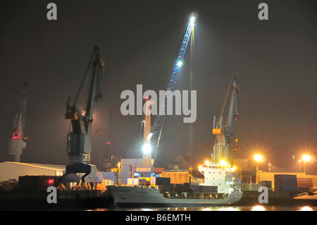Small container ship, Feeder, being unloaded in Hamburg port, Hamburg, Germany, Europe - Stock Photo