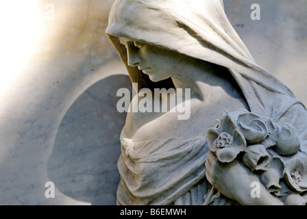 Statue of a grieving woman on a grave in Ohlsdorf Cemetery, Hamburg, Germany, Europe - Stock Photo