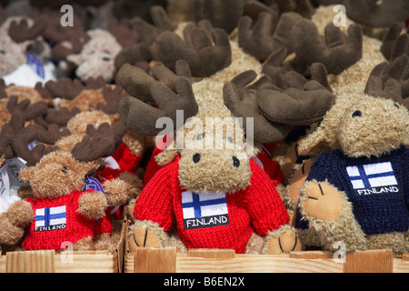 Fluffy Moose tourist gifts wearing Finnish flag sweaters on sale in the Market Square Helsinki Finland - Stock Photo