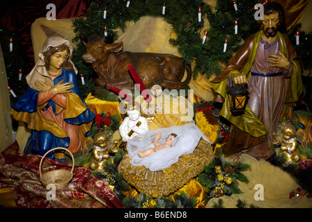 Nativity Scene Maria Mary Joseph Jesus the Christ child of promise Madonna crib manger stable barn animal cow ox - Stock Photo