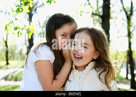 Sisters whispering secrets - Stock Photo