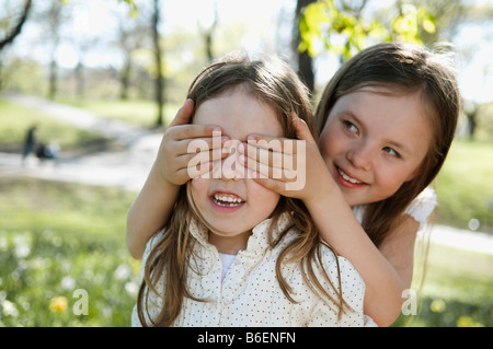 Sisters playing in the nature - Stock Photo