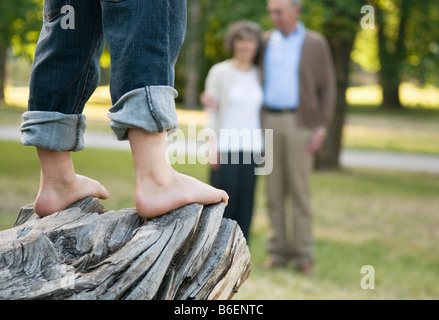 Bare feet on rock - Stock Photo