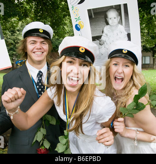 Students with sign - Stock Photo