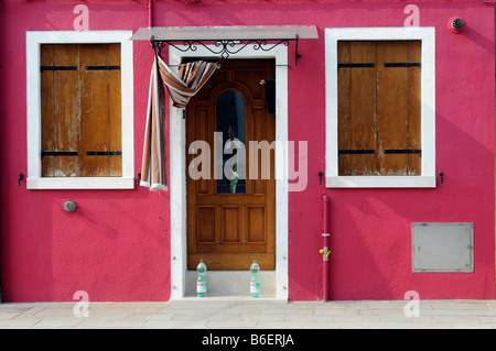 Colorfully painted building facade and entrance in Burano, Venice, Venecia, Italy, Europe - Stock Photo