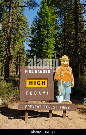 Smokey Bear on a High Fire Danger warning sign in the National Forest, Oregon, USA - Stock Photo