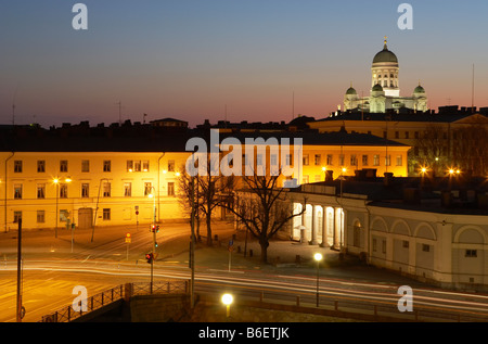 Helsinki skyline and Cathedral at dusk Presidential Palace and Guard Post illuminated in foreground Helsinki Finland - Stock Photo