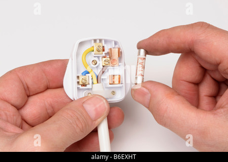 Replacing a 13 Amp fuse in a domestic UK electric plug - Stock Photo