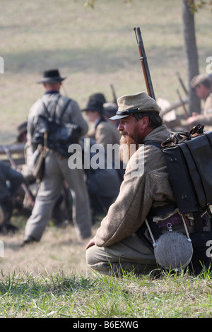 Confederate front line soldiers in battle in the Civil War reenactment at the Wade House Greenbush Wisconsin - Stock Photo