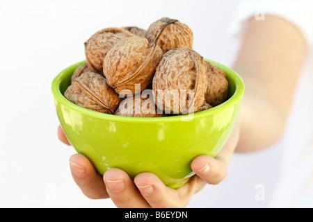 Walnuts and bowl - Stock Photo