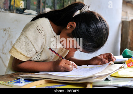 Girl doing her homework, in Beni, Bolivia, South America - Stock Photo