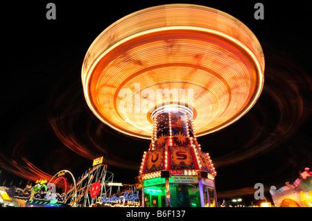 Chain carousel at night, Oktoberfest, Munich, Bavaria, Germany, Europe - Stock Photo