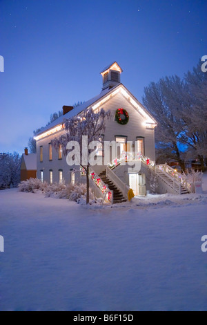 A quaint old pioneer Church with the first stars in the sky at Christmas time in Pioneer Village State Park in Salt - Stock Photo