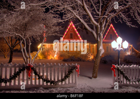 Brigham Young Farmhouse surrounded by snowy trees at Christmas time in Pioneer Village State Park in Salt Lake City - Stock Photo