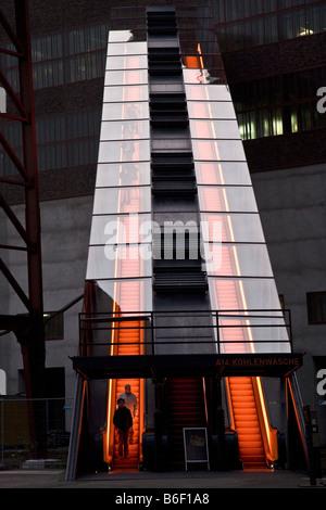 illuminated escalator of World Heritage Site Zeche Zollverein with, Germany, North Rhine-Westphalia, Ruhr Area, - Stock Photo