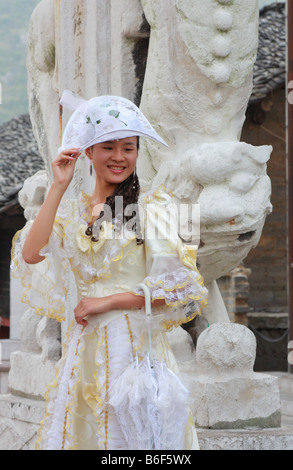 Chinese bride getting photographed in western costume at Ancient town Qingyan in Guizhou Province China - Stock Photo