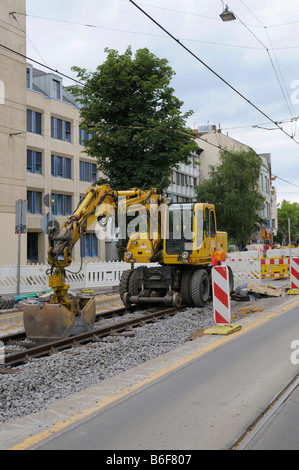 Construction site, tram track construction work, special digger on the rails - Stock Photo