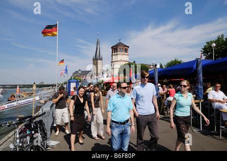 Young people on Duesseldorf's Rhine River waterside promenade, Duesseldorf, North Rhine-Westphalia, Germany, Europe - Stock Photo