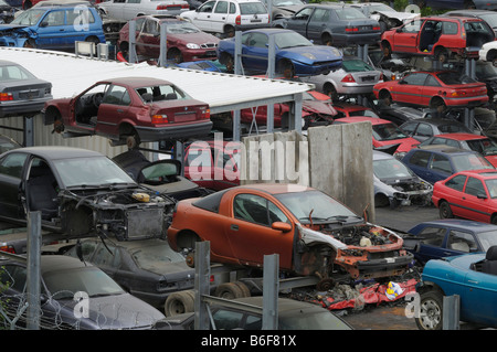 Accumulation of dumped cars, recycling yard, utilization of metal - Stock Photo