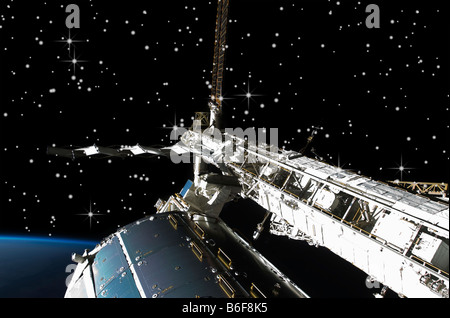 NASA view of International Space Station (ISS) flying above earth - Stock Photo